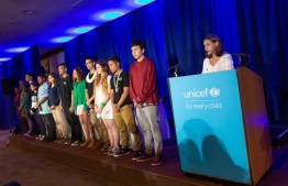 On 23 September 2019, at UNICEF House in New York, (right) Alexandria Villaseñor, 14, from New York, United States of America, stands with 15 other petitioners including Swedish 16-year old climate activist Greta Thunberg in a press conference during which they announced a collective action being taken on behalf of young people everywhere facing the impacts of the climate crisis. PHOTO: UNICEF