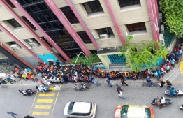 Migrant workers queuing outside the regularisation office of the Ministry of Economics. PHOTO: MIHAARU