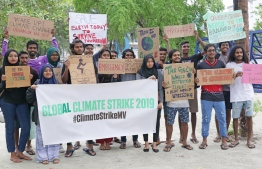 Participants holding up slogans at the Climate Strike in Hulhumale'. PHOTO: HAWWA AMAANY/ THE EDITION