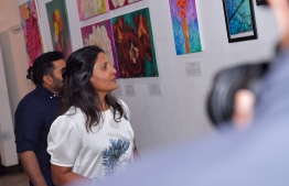 First Lady Fazna Ahmed observing the artwork displayed at In My Mind exhibition. PHOTO: PRESIDENT'S OFFICE