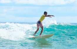 A surfer at the 3rd Soneva Surf Pro Competition, hosted in Baa Atoll this year. PHOTO: HAWWA AMAANY ABDULLA / THE EDITION