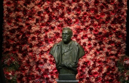 (FILES) In this file photo taken on December 10, 2016 A bust of Alfred Nobel is pictured prior to the awardings of the Nobel Prizes in medicine, economics, physics and chemistry in Stockholm, Sweden. - Nobel laureates are honoured every year on December 10 -- the anniversary of the death of prize's founder Alfred Nobel, a Swedish industrialist, inventor and philanthropist. (Photo by Soren Andersson / AFP)