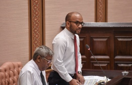 Minister of Finance Ibrahim Ameer speaks at a parliament sitting. PHOTO/MAJILIS