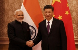 Indian Prime Minister Narendra Modi and Chinese President Xi Jinping. PHOTO: AFP