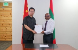 Minister of Foreign Affairs Abdulla Shahid and Chinese Ambassador to Maldives Zhang Lizhong. PHOTO: MINISTRY OF FOREIGN AFFAIRS