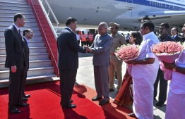 In this handout photograph taken and released by Indian Ministry of External Affairs (MEA) on October 11, 2019, China's President Xi Jinping (3L) arrives in Chennai, to attend a summit with India's Prime Minister Narendra Modi at the World Heritage Site of Mahabalipuram from October 11 to 12 in Tamil Nadu state. (Photo by Handout / Indian Ministry of External Affairs (MEA) / AFP) /