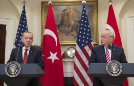 (FILES) In this file photo taken on May 16, 2017 US President Donald Trump and Turkish President Recep Tayyip Erdogan speak to the press in the Roosevelt Room of the White House in Washington, DC. - Facing a backlash for appearing to greenlight Turkey's assault against Kurdish forces in Syria, President Donald Trump on October 11, 2019 dialed up pressure on America's NATO ally by threatening crippling sanctions. (Photo by SAUL LOEB / AFP)