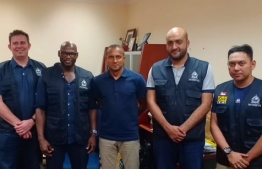 Police Commissioner Mohamed Hameed (C) with the team from Interpol. PHOTO: MC HAMEED / TWITTER