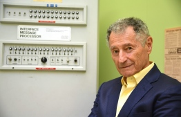 "Dr. Leonard Kleinrock poses beside the first Interface Message Processor (IMP) in the lab where the first internet message was sent, at the University of California Los Angeles (UCLA) on September, 24, 2019 in Los Angeles, California, one month ahead of celebrations to mark the 50th anniversary of the creation of the internet. - On October 29, 1969, professor Leonard Kleinrock and a team at the University of California at Los Angeles got a computer to ""talk"" to a machine in what is now known as Silicon Valley. The event gave birth to a network that later became known as the internet -- hailed at first as a boon to equality and enlightenment, but with a dark side that has emerged as well. (Photo by Robyn Beck / AFP)"