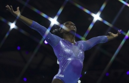 USA's Simone Biles performs to win the floor event during the apparatus finals at the FIG Artistic Gymnastics World Championships at the Hanns-Martin-Schleyer-Halle in Stuttgart, southern Germany, on October 13, 2019. (Photo by Lionel BONAVENTURE / AFP)