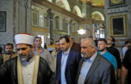 A Saudi football delegation visited east Jerusalem's Al-Aqsa mosque on October 14, 2019, on the eve of a groundbreaking trip to play a match against Palestinians in the occupied West Bank PHOTO: AHMAD GHARABLI / AFP