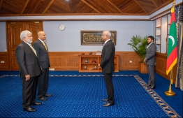 President Ibrahim Mohamed Solih presenting the letter of appointment to Mohamed Shihab and Mohamed Mahir Easa. PHOTO: PRESIDENT'S OFFICE