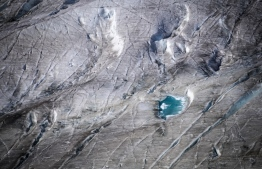 (FILES) In this file photo taken on October 01, 2019 This picture taken on October 01, 2019 shows the surface of Aletsch glacier above Bettmeralp, Swiss Alps. - The mighty Aletsch -- the largest glacier in the Alps -- could completely disappear by the end of this century if nothing is done to rein in climate change, a study showed on September 12, 2019 by ETH technical university in Zurich. (Photo by Fabrice COFFRINI / AFP)