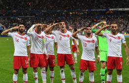 Turkish players salute at the end of the Euro 2020 Group H qualification football match between France and Turkey at the Stade de France in Saint-Denis, outside Paris on October 14, 2019. (Photo by Alain JOCARD / AFP)