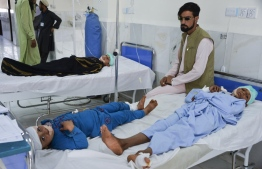 Children receive medical treatment in a hospital after being injured in a bomb blast in Alishang, Laghman province, on October 16, 2019. - At least three people were killed and about 20 children wounded when a Taliban truck bomb detonated near a rural police station and partially destroyed a nearby religious school, Afghan officials said. (Photo by NOORULLAH SHIRZADA / AFP)