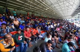 Expatriate workers waiting in the National Stadium for re-registration. PHOTO: HUSSAIN WAHEED/ MIHAARU