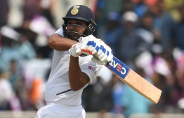 India's Rohit Sharma plays a shot during the first day of the third and final Test match between India and South Africa at the Jharkhand State Cricket Association (JSCA) stadium in Ranchi on October 19, 2019. (Photo by Money SHARMA / AFP) /