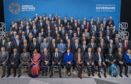 In this image released by the International Monetary Fund, Members of the International Monetary and Financial Committee (IMFC) pose for a group photograph October 19, 2019 at the IMF Headquarters during the 2019 IMF/World Bank Annual Meetings in Washington, DC. (Photo by Stephen JAFFE / AFP) /