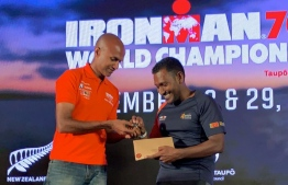 Prominent lawyer Hussain Shameem receives his qualification coin for the Ironman 70.3 World Championship 2020. PHOTO: MIHAARU FILES