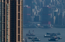 (FILES) In this file photo taken on August 20, 2019 Barges and cargo ships are seen in the waters of Hong Kong's Victoria Harbour on August 20, 2019. - Shipowners say they are trying to cut their heavy-polluting industry's impact on the environment by using cleaner energy -- but some have stalled over limiting the speed of ships. (Photo by Philip FONG / AFP)