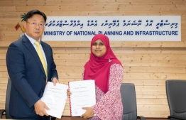 National Planning Ministry's Permanent Secretary Zeeniya Ahmed signs agreement to award the development of a new office complex in Hulhumale' to Hunan Construction Engineering of China. PHOTO/NATIONAL PLANNING MINISTRY