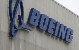 "(FILES) In this file photo taken on March 12, 2019 the Boeing logo is pictured at the Boeing Renton Factory in Renton, Washington. - Boeing reported on October 23, 2019 a sharp drop in third-quarter earnings due to the 737 MAX grounding, but said it still expects regulatory approval this year to return the plane to service. The aviation giant, which has been in crisis mode following two MAX crashes that killed 346 people, said it ""has assumed that regulatory approval of the 737 MAX return to service begins in the fourth quarter of 2019."" (Photo by Jason Redmond / AFP)"