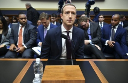 "Facebook Chairman and CEO Mark Zuckerberg arrives to testify before the House Financial Services Committee on ""An Examination of Facebook and Its Impact on the Financial Services and Housing Sectors"" in the Rayburn House Office Building in Washington, DC on October 23, 2019. (Photo by MANDEL NGAN / AFP)"