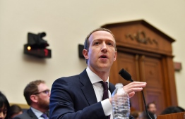 "Facebook Chairman and CEO Mark Zuckerberg testifies before the House Financial Services Committee on ""An Examination of Facebook and Its Impact on the Financial Services and Housing Sectors"" in the Rayburn House Office Building in Washington, DC on October 23, 2019. (Photo by Nicholas Kamm / AFP)"
