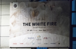 The exhibition banner of Azmeel's 'The White Fire: The plight of coral reefs' outside the National Art Gallery. PHOTO: AHMED AIHAM / THE EDITION