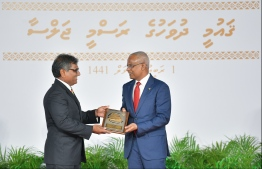 President Solih presents National Award of Recognition to Ibrahim Solih, for his contributions to promoting arts and crafts. PHOTO: HUSSAIN WAHEED / MIHAARU