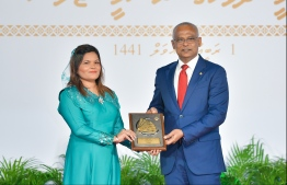 President Solih presents National Award of Recognition to Zeenaz Hussain, for her contributions in the field of tourism and training tourism-sector staff. PHOTO: HUSSAIN WAHEED / MIHAARU