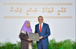 President Solih presents National Award of Recognition to Rahma Easa, for her contributions in the area of human rights and social protection. PHOTO: HUSSAIN WAHEED / MIHAARU