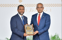 President Solih presents National Award of Recognition to Ahmed Afaal, for his contributions in health sector development. PHOTO: HUSSAIN WAHEED / MIHAARU