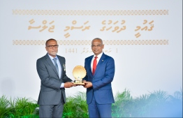 President Solih presents National Award of Honour to Sayyid Ali, for his contributions to sports in sportsmanship and sports development. PHOTO: HUSSAIN WAHEED / MIHAARU