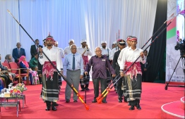 Ahmed Adam and Abdulla Sodiq are escorted to the stage, to be conferred the Order of the Distinguished Rule of Izzuddin. PHOTO: HUSSAIN WAHEED / MIHAARU
