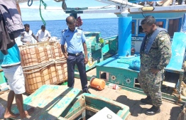 Maldives Police Service and Maldives' Coastguard operating on the seized Iran flagged vessel. PHOTO: MALDIVES NATIONAL DEFENCE FORCE (MNDF)