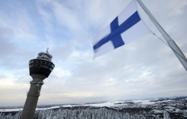 A national Finish flag flies close to Puijo hill's observation tower on March 8, 2010 as training and qualification round of the Ski jumping world cup were cancelled due to bad wind conditions in Kuopio.    AFP PHOTO/ LEHTIKUVA/ MARTTI KAINULAINEN     ***  ***