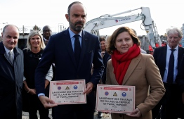 French Prime Minister Edouard Philippe and French Sports Minister Roxana Maracineanu pose during a ceremony marking the start of the constructions of the future Olympic and paralympic games village for Paris 2024 Olympic games, on November 4, 2019 in Saint-Ouen. (Photo by GONZALO FUENTES / POOL / AFP)