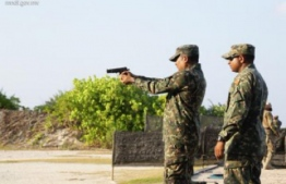 Military personnel training with firearms at Girifushi. Live rounds were used almost daily in these training sessions prior to the ban. PHOTO: MIHAARU FILES
