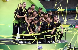 Australia players celebrate their victory in the Twenty20 cricket series against Pakistan at Optus Stadium in Perth on November 8, 2019. (Photo by Tony ASHBY / AFP) /