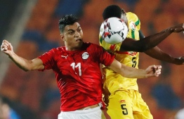 Mali's Youssouf Traore in action with Egypt's Mostafa Mohamed Africa Under 23 Cup of Nations at Cairo International Stadium in Egypt on November 8, 2019. PHOTO: REUTERS