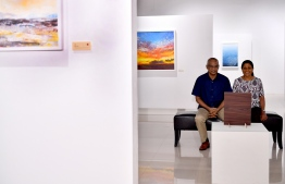 President Ibrahim Mohamed Solih and First Lady Fazna Ahmed observing a painting by Ahmed Amir at his art exhibit 'Impermanence'. PHOTO: PRESIDENT'S OFFICE