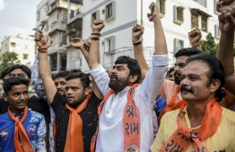 Supporters of the Vishwa Hindu Parishad (VHP) organisation celebrate the Indian Supreme Court's verdict on disputed religious site in Ayodhya awarded to Hindus, in Ahmedabad on November 9, 2019. - India's top court handed a huge victory to Prime Minister Narendra Modi's Hindu nationalist party on November 9 by awarding Hindus control of a bitterly disputed holy site that has sparked deadly sectarian violence in the past. (Photo by SAM PANTHAKY / AFP)