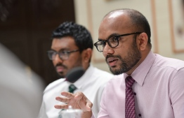 Minister of Finance Ibrahim Ameer speaking at a parliament meeting. PHOTO: NISHAN ALI/ MIHAARU