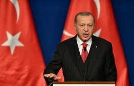 (FILES) In this file photo taken on November 07, 2019 Turkish President Recep Tayyip Erdogan speaks during a joint press conference with Hungarian Prime Minister at Varkert Bazar cultural center in Budapest. (Photo by Attila KISBENEDEK / AFP)