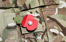 This picture taken on November 5, 2019 during the the International Maritime Exercise (IMX) in the Gulf waters off Bahrain shows a close-up of a remembrance poppy worn by a British serviceman during the exercises. - IMX is a joint military exercise involving assets and personnel from more than 50 partner nations and seven international organisations. The US has pushed for the creation of a US-led operation dubbed the International Maritime Security Construct to safeguard trade and the flow of oil through the Strait of Hormuz. It has so far been joined by Australia, Britain and the United Arab Emirates, as well as Bahrain, the Gulf island state which is home to the US Fifth Fleet. (Photo by KARIM SAHIB / AFP)