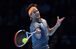 Austria's Dominic Thiem returns against Serbia's Novak Djokovic during their men's singles round-robin match on day three of the ATP World Tour Finals tennis tournament at the O2 Arena in London on November 12, 2019. (Photo by Glyn KIRK / AFP)