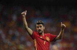 (FILES) In this file photo taken on September 2, 2017 Spain's forward David Villa waves as he celebrates their victory at the end of the World Cup 2018 qualifier football match Spain vs Italy at the Santiago Bernabeu stadium in Madrid. - Star striker Villa, who holds the record for most international goals scored for Spain, announced on November 13, 2019 he was quitting professional football at the end of the season. (Photo by GABRIEL BOUYS / AFP)