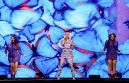 US singer Taylor Swift (C) performs during the 2019 Tmall 11:11 Global Shopping Festival gala in Shanghai on November 10, 2019. (Photo by STR / AFP) /