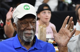 (FILES) In this file photo taken on July 20, 2019 basketball Hall of Fame member Bill Russell waves as he is introduced at a game between the Minnesota Lynx and the Las Vegas Aces at the Mandalay Bay Events Center in Las Vegas, Nevada. - Bill Russell accepted his Basketball Hall of Fame ring on Friday after refusing it in 1975, the 11-time NBA champion saying other black players deserved to be enshrined before him. The 85-year-old NBA legend led the Boston Celtics to a record 11 league crowns from 1957 to 1969 and was selected as the NBA Most Valuable Player five times. (Photo by Ethan Miller / GETTY IMAGES NORTH AMERICA / AFP)